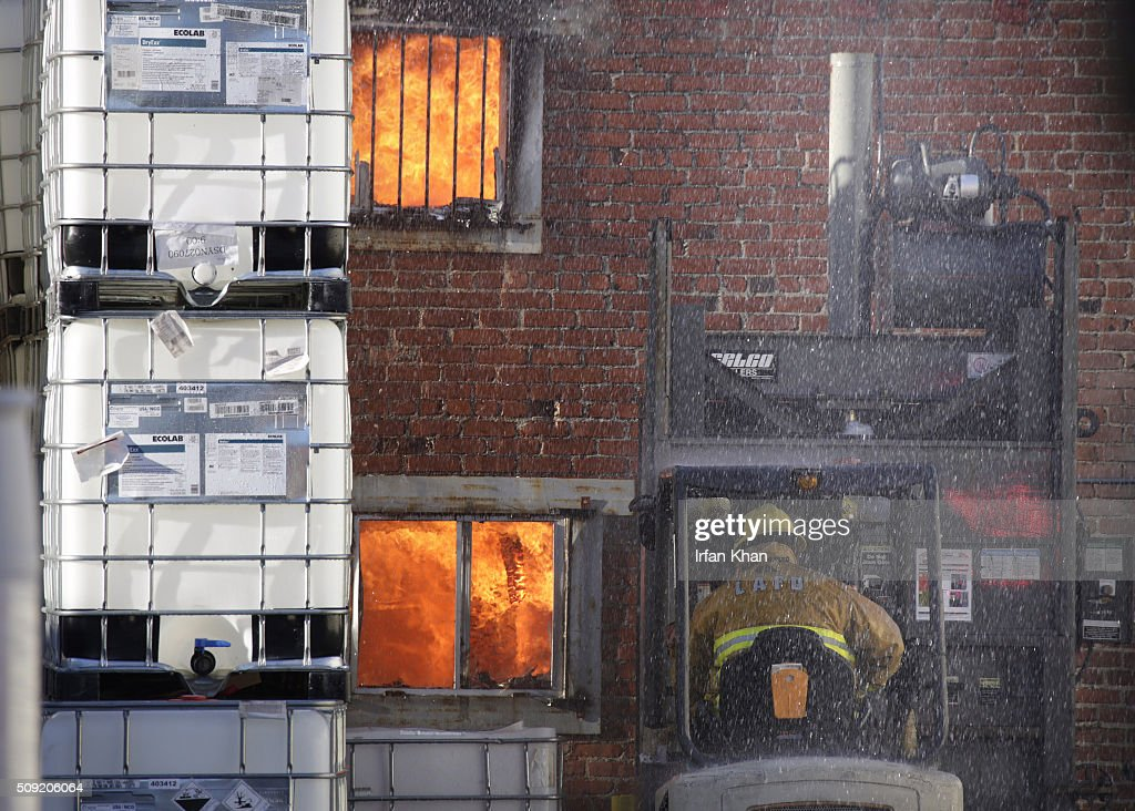 LOS ANGELES, CA FEBRUARY 9, 2016 -- Los Angeles city firefighters battle a blaze in the 1300 block of Newton Street in downtown Los Angeles Tuesday morning, February 9, 2016. A firefighter fell and suffered minor injuries while battling a blaze, according to Brian Humphrey of the Los Angeles Fire Department.