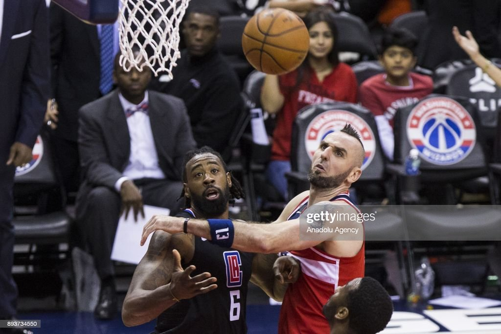 Los Angeles Clipper DeAndre Jordan (6) and Washington Wizard Marcin Gortat (13) go for a rebound at the Capital One Arena in Washington, USA on December 15, 2017.