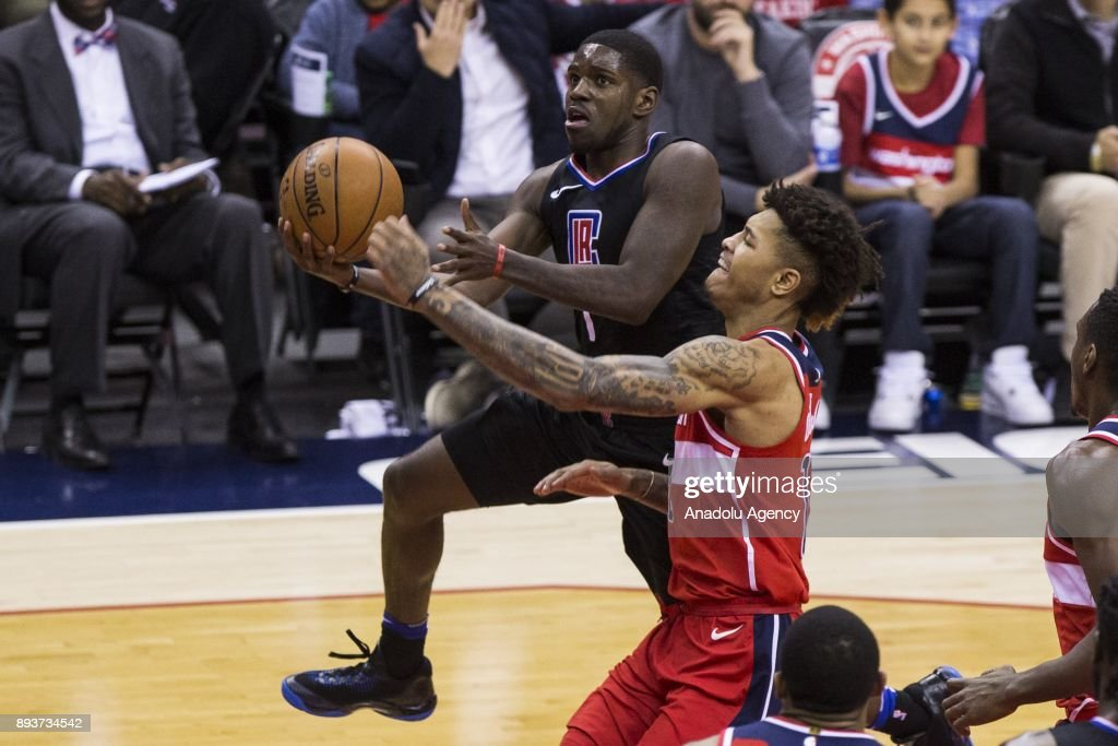 Los Angeles Clipper Jawun Evans (1) goes for a layup past Washington Wizard Kelly Oubre Jr. (12) at the Capital One Arena in Washington, USA on December 15, 2017.