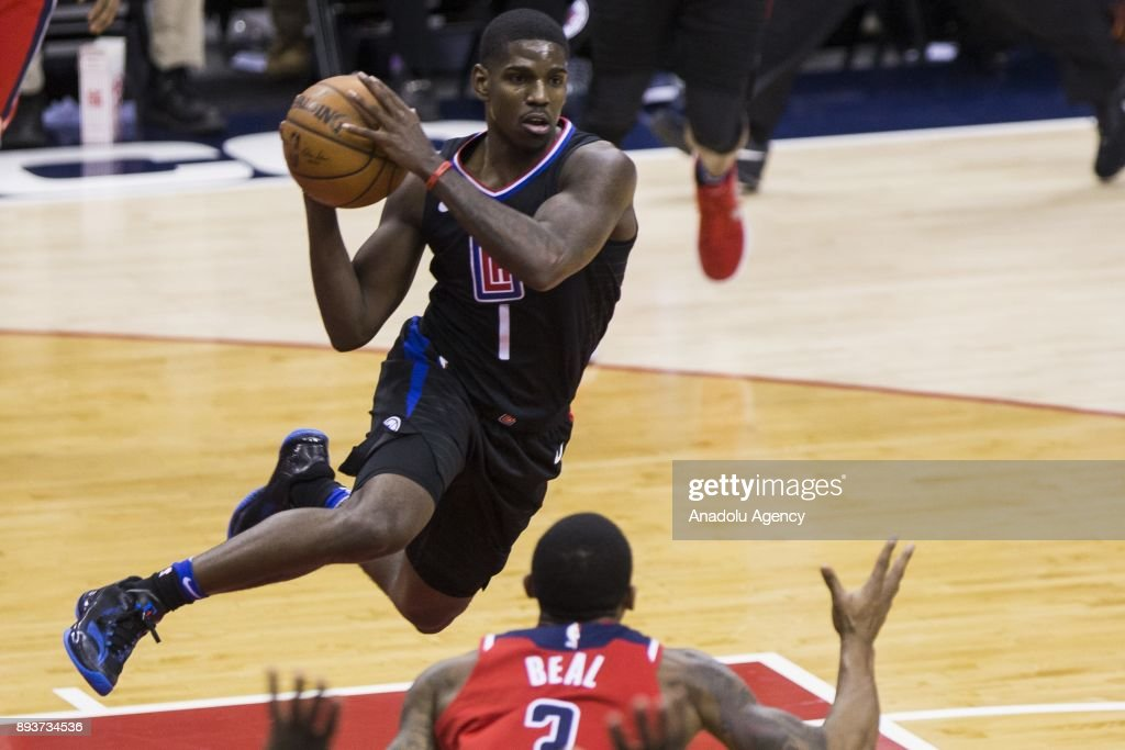 Los Angeles Clipper Jawun Evans (1) jumps in the air to pass the ball against the Washington Wizards at the Capital One Arena in Washington, USA on December 15, 2017.