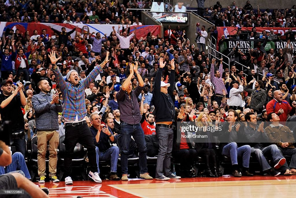 Los Angeles Clippers fans celebrate during a game against the Dallas Mavericks at Staples Center on January 9, 2013 in Los Angeles, California.