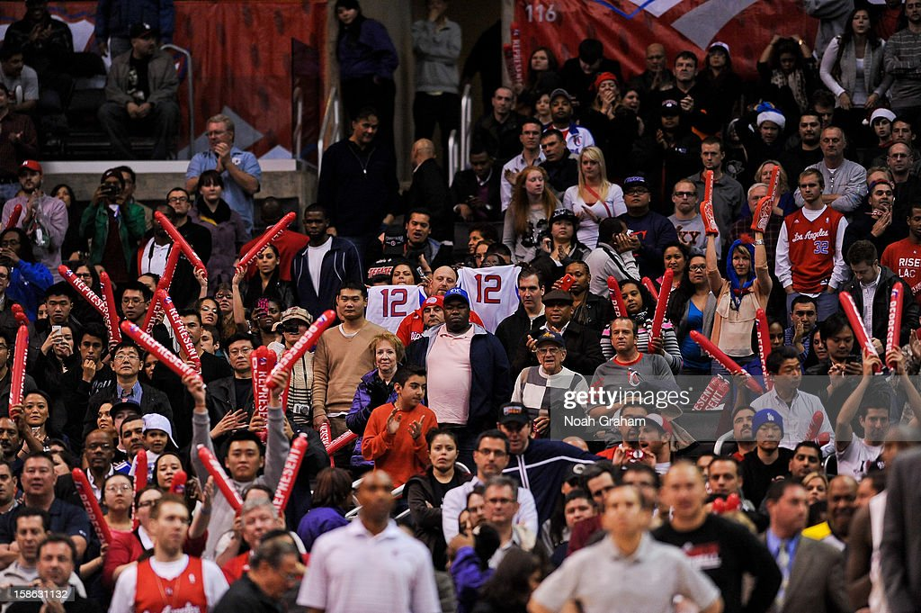 Los Angeles Clippers fans celebrate their team's 12th straight victory during a game played against the Sacramento Kings at Staples Center on December 21, 2012 in Los Angeles, California.