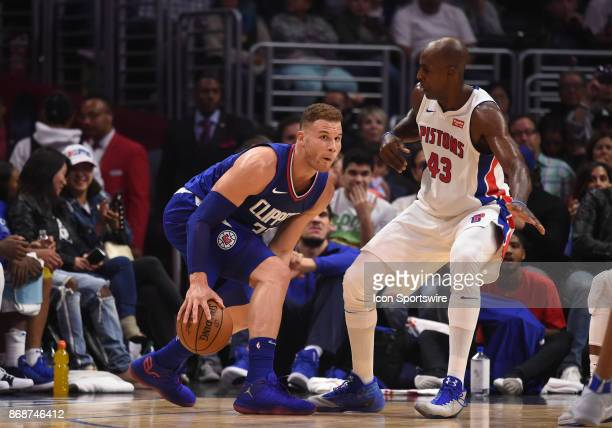 Los Angeles Clippers Forward Blake Griffin dribbles through his legs while being guarded by Detroit Pistons Forward Anthony Tolliver during an NBA...