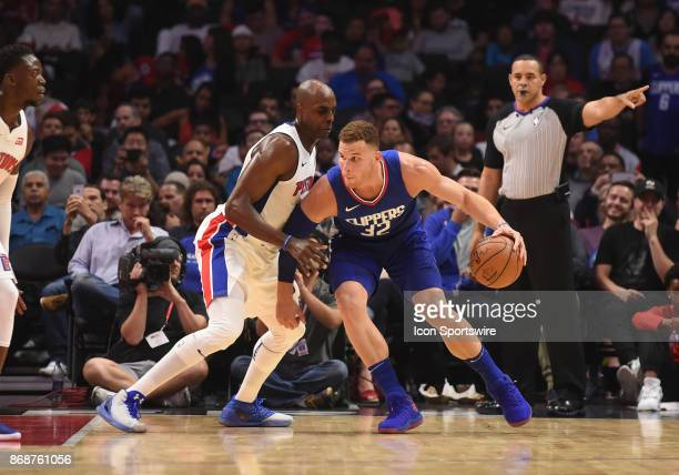 Los Angeles Clippers Forward Blake Griffin pushes his way through Detroit Pistons Forward Anthony Tolliver during an NBA game between the Detroit...