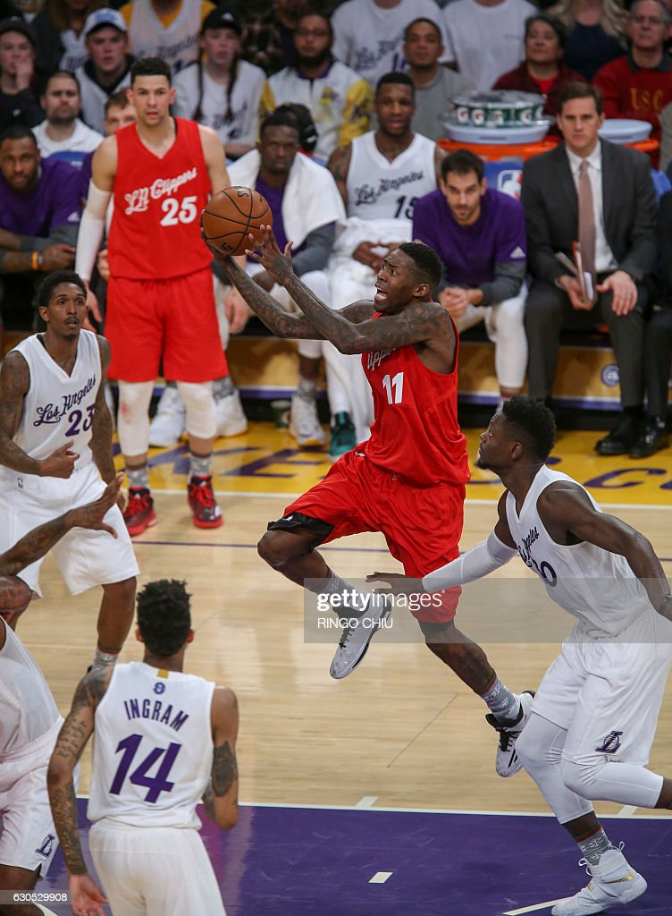 Los Angeles Clippers forward Jamal Crawford (#11) goes up against Los Angeles Lakers during their NBA game at Staples Center in Los Angeles, California on December 25, 2016. The Lakers won 111-102. / AFP / RINGO