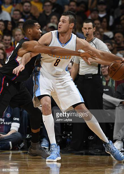 Los Angeles Clippers forward Wesley Johnson reaches in on Denver Nuggets forward Danilo Gallinari during their game against the Denver Nuggets...