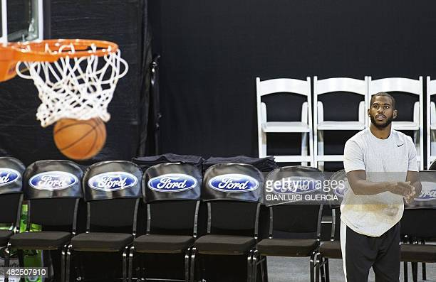 Los Angeles Clippers guard Chris Paul watches the ball fall through the hoop during a training session at the Ellis Park Johannesburg arena on July...