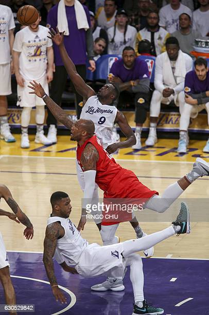 Los Angeles Clippers guard Raymond Felton goes up for a shot against Los Angeles Lakers forward Thomas Robinson during their NBA game at Staples...