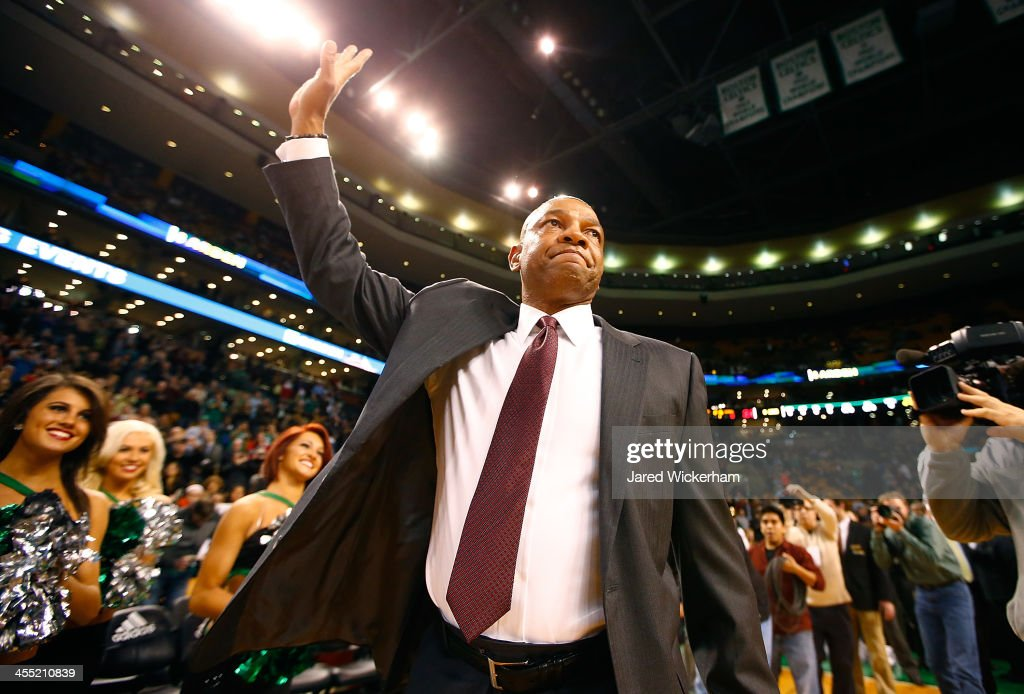 Los Angeles Clippers head coach, <a gi-track='captionPersonalityLinkClicked' href=/galleries/search?phrase=Doc+Rivers&family=editorial&specificpeople=206225 ng-click='$event.stopPropagation()'>Doc Rivers</a>, acknowledges the crowd prior to the game against his former team, the Boston Celtics, at TD Garden on December 11, 2013 in Boston, Massachusetts.