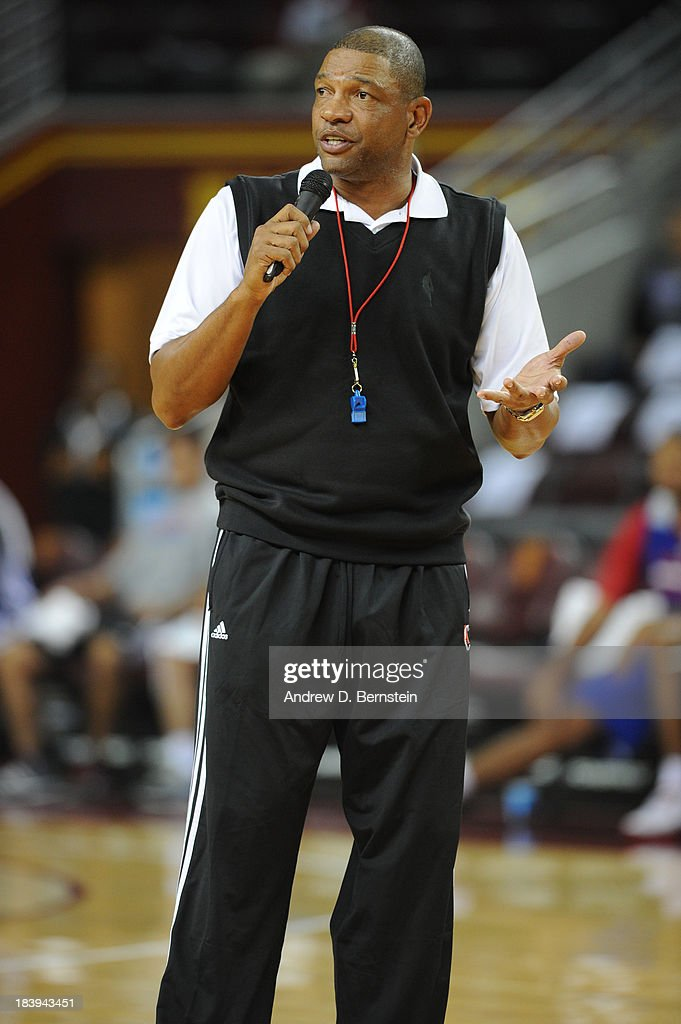 Los Angeles Clippers Head Coach Doc Rivers addresses fans during a Los Angeles Clippers open scrimmage at Galen Center on October 9, 2013 in Los Angeles, California.