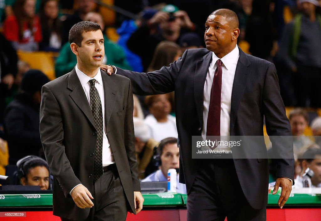 Los Angeles Clippers head coach, Doc Rivers, and Boston Celtics head coach, Brad Stevens, greet each other following the end of game at TD Garden on December 11, 2013 in Boston, Massachusetts.