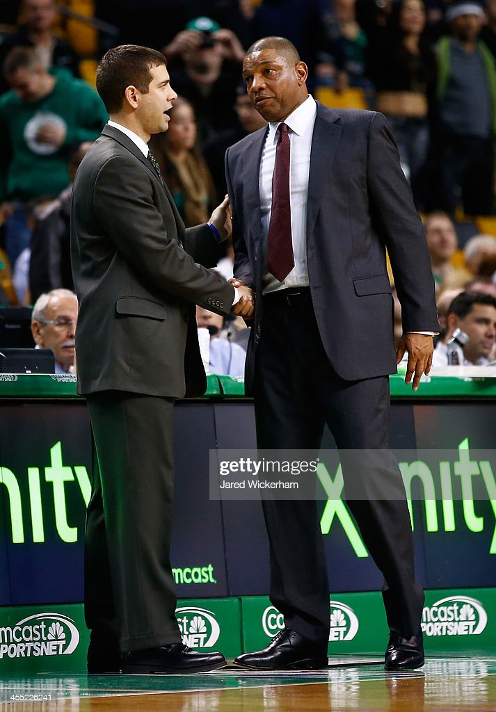 Los Angeles Clippers head coach, <a gi-track='captionPersonalityLinkClicked' href=/galleries/search?phrase=Doc+Rivers&family=editorial&specificpeople=206225 ng-click='$event.stopPropagation()'>Doc Rivers</a>, and Boston Celtics head coach, <a gi-track='captionPersonalityLinkClicked' href=/galleries/search?phrase=Brad+Stevens&family=editorial&specificpeople=5022542 ng-click='$event.stopPropagation()'>Brad Stevens</a>, greet each other following the end of game at TD Garden on December 11, 2013 in Boston, Massachusetts.