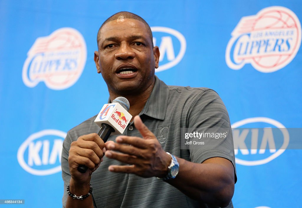 Los Angeles Clippers head coach <a gi-track='captionPersonalityLinkClicked' href=/galleries/search?phrase=Doc+Rivers&family=editorial&specificpeople=206225 ng-click='$event.stopPropagation()'>Doc Rivers</a> takes questions from the media during Los Angeles Clippers Media Day at Los Angeles Clippers Training Center on September 29, 2014 in Playa Vista, California.