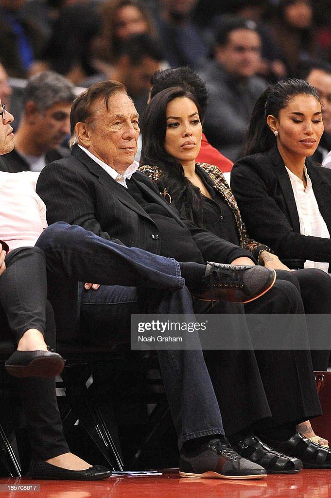 Los Angeles Clippers owner <a gi-track='captionPersonalityLinkClicked' href=/galleries/search?phrase=Donald+Sterling&family=editorial&specificpeople=630317 ng-click='$event.stopPropagation()'>Donald Sterling</a> and <a gi-track='captionPersonalityLinkClicked' href=/galleries/search?phrase=V.+Stiviano&family=editorial&specificpeople=12772991 ng-click='$event.stopPropagation()'>V. Stiviano</a> (far right) look on from their seats during a game against the Utah Jazz at Staples Center on October 23, 2013 in Los Angeles, California.
