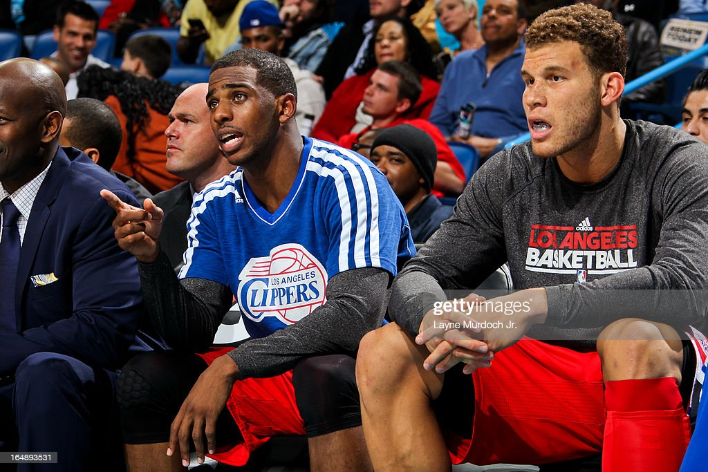 Los Angeles Clippers players <a gi-track='captionPersonalityLinkClicked' href=/galleries/search?phrase=Chris+Paul&family=editorial&specificpeople=212762 ng-click='$event.stopPropagation()'>Chris Paul</a> #3, left, and <a gi-track='captionPersonalityLinkClicked' href=/galleries/search?phrase=Blake+Griffin+-+Basketball+Player&family=editorial&specificpeople=4216010 ng-click='$event.stopPropagation()'>Blake Griffin</a> #32 look on from the bench during a game against the New Orleans Hornets on March 27, 2013 at the New Orleans Arena in New Orleans, Louisiana.