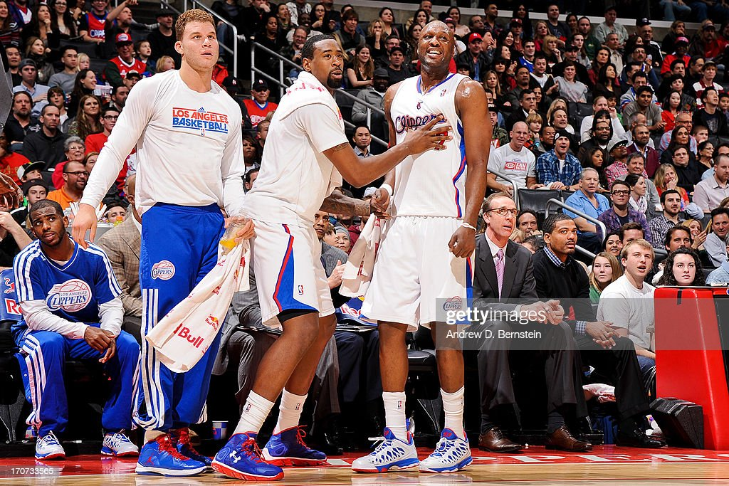 Los Angeles Clippers players, from left, <a gi-track='captionPersonalityLinkClicked' href=/galleries/search?phrase=Blake+Griffin+-+Basketball+Player&family=editorial&specificpeople=4216010 ng-click='$event.stopPropagation()'>Blake Griffin</a> #32, <a gi-track='captionPersonalityLinkClicked' href=/galleries/search?phrase=DeAndre+Jordan&family=editorial&specificpeople=4665718 ng-click='$event.stopPropagation()'>DeAndre Jordan</a> #6 and <a gi-track='captionPersonalityLinkClicked' href=/galleries/search?phrase=Lamar+Odom&family=editorial&specificpeople=201519 ng-click='$event.stopPropagation()'>Lamar Odom</a> #7 celebrate from the sideline as their teammates play the Sacramento Kings at Staples Center on December 21, 2012 in Los Angeles, California.