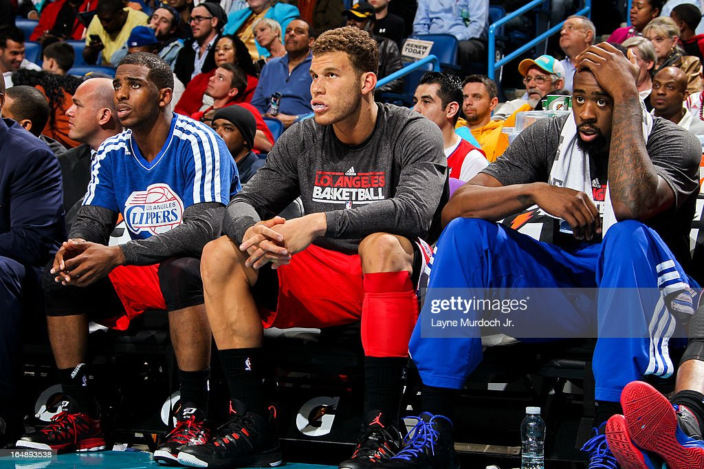 Los Angeles Clippers players, from left, <a gi-track='captionPersonalityLinkClicked' href=/galleries/search?phrase=Chris+Paul&family=editorial&specificpeople=212762 ng-click='$event.stopPropagation()'>Chris Paul</a> #3, <a gi-track='captionPersonalityLinkClicked' href=/galleries/search?phrase=Blake+Griffin+-+Basketball+Player&family=editorial&specificpeople=4216010 ng-click='$event.stopPropagation()'>Blake Griffin</a> #32, and <a gi-track='captionPersonalityLinkClicked' href=/galleries/search?phrase=DeAndre+Jordan&family=editorial&specificpeople=4665718 ng-click='$event.stopPropagation()'>DeAndre Jordan</a> #6 look on from the bench during a game against the New Orleans Hornets on March 27, 2013 at the New Orleans Arena in New Orleans, Louisiana.