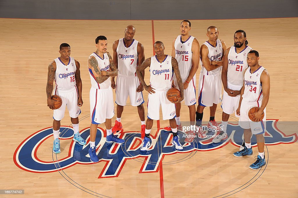 Los Angeles Clippers players, from left, Eric Bledsoe #12, Matt Barnes #22, Lamar Odom #7, Jamal Crawford #11, Ryan Hollins #15, Grant Hill #33, Ronny Turiaf #21 and Willie Green #34 pose for a group photo in their practice facility on April 5, 2013 in Playa Vista, California.