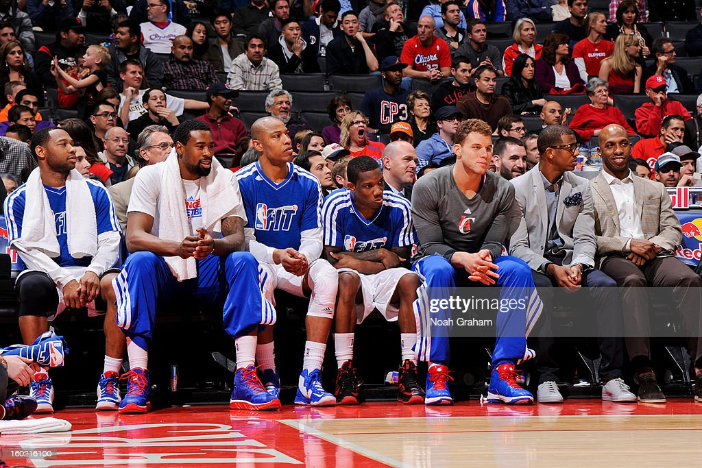 Los Angeles Clippers players, from left, <a gi-track='captionPersonalityLinkClicked' href=/galleries/search?phrase=Willie+Green&family=editorial&specificpeople=201653 ng-click='$event.stopPropagation()'>Willie Green</a> #34, <a gi-track='captionPersonalityLinkClicked' href=/galleries/search?phrase=DeAndre+Jordan&family=editorial&specificpeople=4665718 ng-click='$event.stopPropagation()'>DeAndre Jordan</a> #6, <a gi-track='captionPersonalityLinkClicked' href=/galleries/search?phrase=Caron+Butler&family=editorial&specificpeople=201744 ng-click='$event.stopPropagation()'>Caron Butler</a> #5, <a gi-track='captionPersonalityLinkClicked' href=/galleries/search?phrase=Eric+Bledsoe&family=editorial&specificpeople=6480906 ng-click='$event.stopPropagation()'>Eric Bledsoe</a> #12, <a gi-track='captionPersonalityLinkClicked' href=/galleries/search?phrase=Blake+Griffin+-+Jugador+de+baloncesto&family=editorial&specificpeople=4216010 ng-click='$event.stopPropagation()'>Blake Griffin</a> #32, <a gi-track='captionPersonalityLinkClicked' href=/galleries/search?phrase=Chris+Paul&family=editorial&specificpeople=212762 ng-click='$event.stopPropagation()'>Chris Paul</a> #3, and <a gi-track='captionPersonalityLinkClicked' href=/galleries/search?phrase=Chauncey+Billups&family=editorial&specificpeople=201508 ng-click='$event.stopPropagation()'>Chauncey Billups</a> #1 look on from the bench during a game against the Portland Trail Blazers at Staples Center on January 27, 2013 in Los Angeles, California.
