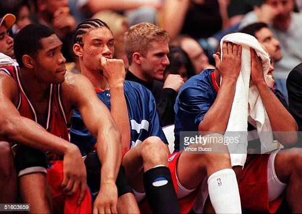 Los Angeles Clippers players MIchael Olowokandi Keith Closs Jr and Pooh Richardson sit on bench near the end of their 10 March 1999 game against the...
