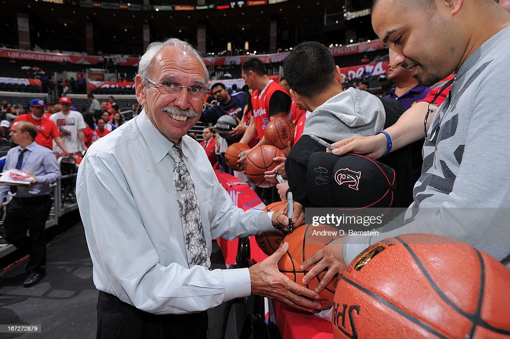 Los Angeles Clippers Radio/TV personality Ralph Lawler signs autographs before the game against the Memphis Grizzlies at Staples Center on March 13, 2013 in Los Angeles, California.