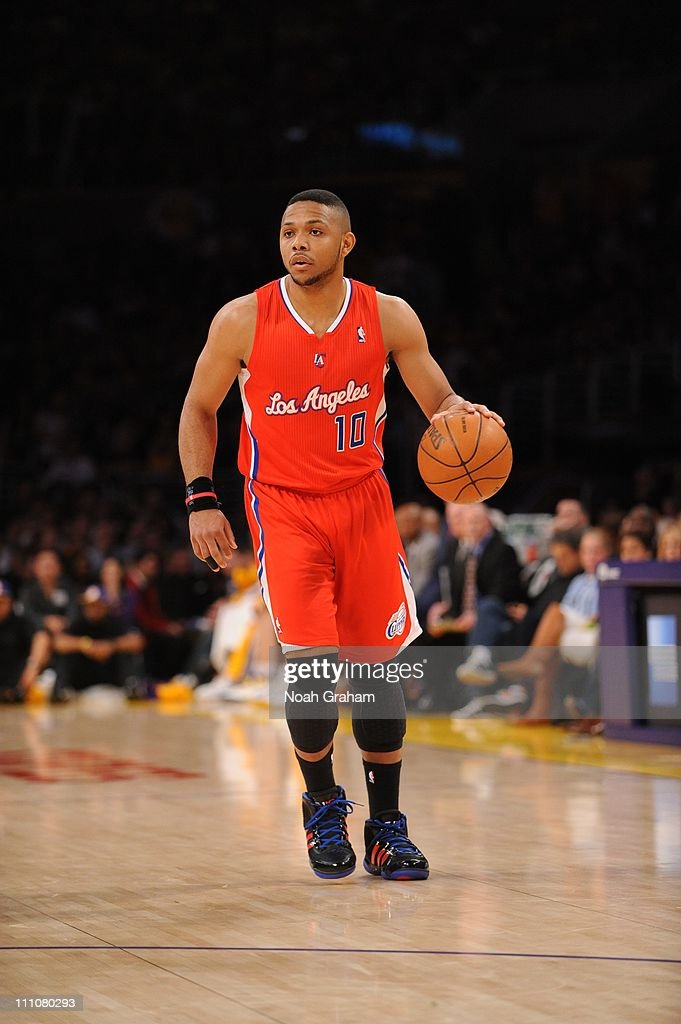 Los Angeles Clippers shooting guard <a gi-track='captionPersonalityLinkClicked' href=/galleries/search?phrase=Eric+Gordon+-+Basketball+Player&family=editorial&specificpeople=4212733 ng-click='$event.stopPropagation()'>Eric Gordon</a> #10 brings the ball up court during the game against the Los Angeles Lakers at Staples Center on March 25, 2011 in Los Angeles, California. The Lakers won 112-104.