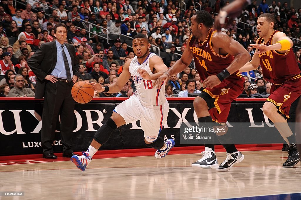 Los Angeles Clippers shooting guard <a gi-track='captionPersonalityLinkClicked' href=/galleries/search?phrase=Eric+Gordon+-+Basketball+Player&family=editorial&specificpeople=4212733 ng-click='$event.stopPropagation()'>Eric Gordon</a> #10 drives to the basket during the game against the Cleveland Cavaliers at Staples Center on March 19, 2011 in Los Angeles, California. The Clippers won 100-92.