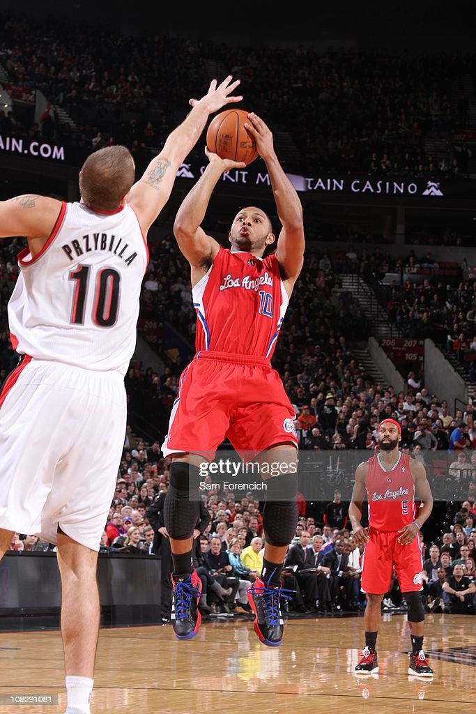 Los Angeles Clippers shooting guard <a gi-track='captionPersonalityLinkClicked' href=/galleries/search?phrase=Eric+Gordon+-+Basketball+Player&family=editorial&specificpeople=4212733 ng-click='$event.stopPropagation()'>Eric Gordon</a> #10 goes for a jump shot during a game against the Portland Trail Blazers on January 20, 2011 at the Rose Garden Arena in Portland, Oregon. The Portland Trail Blazers won 108-93.