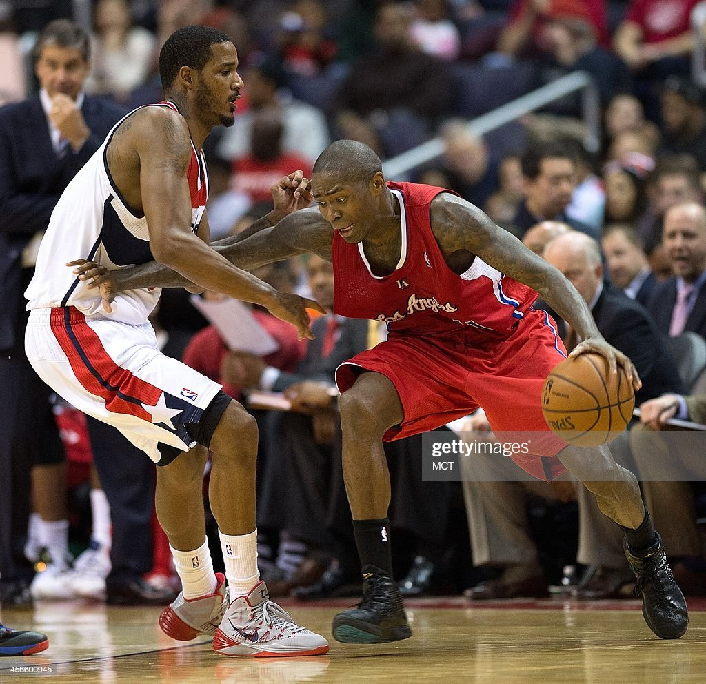 Los Angeles Clippers shooting guard Jamal Crawford (11) drives against Washington Wizards small forward Trevor Ariza (1) during the second half of their game played at the Verizon Center in Washington, Saturday, Dec. 14, 2013. Los Angeles defeated Washington 113-97.