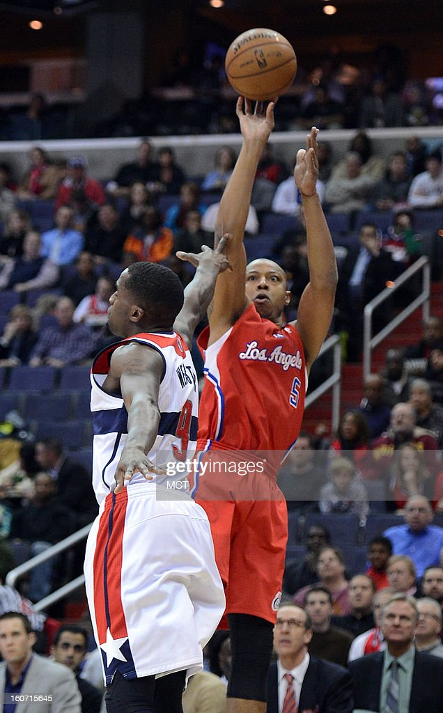 Los Angeles Clippers small forward Caron Butler (5) hits a jump shot over Washington Wizards small forward Martell Webster (9) in the first quarter at the Verizon Center in Washington, D.C., Monday, February 4, 2013.