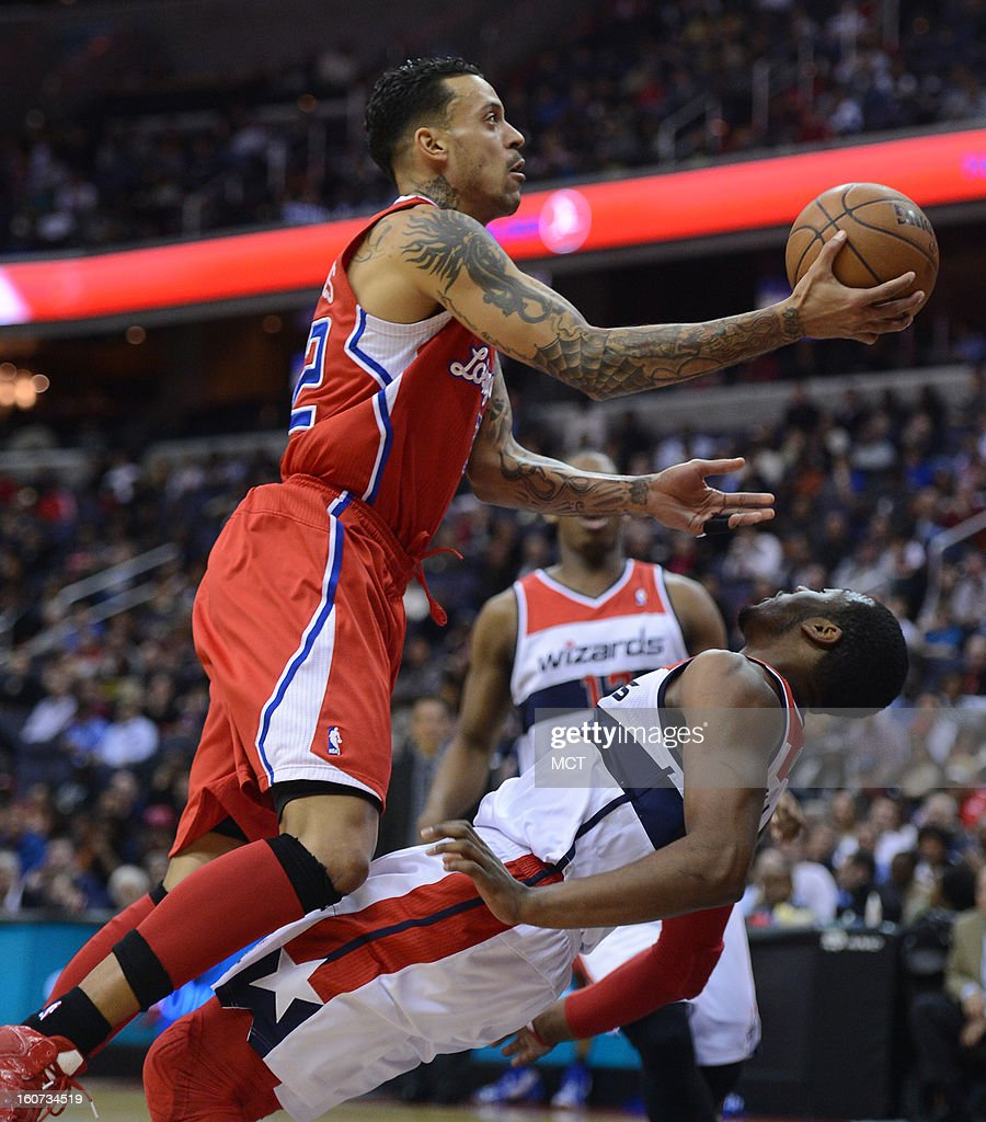 Los Angeles Clippers small forward Matt Barnes (22), left, commits a charging foul on Washington Wizards point guard John Wall (2) in the second quarter at the Verizon Center in Washington, D.C., Monday, February 4, 2013. The Wizards defeated the Clippers, 98-90.