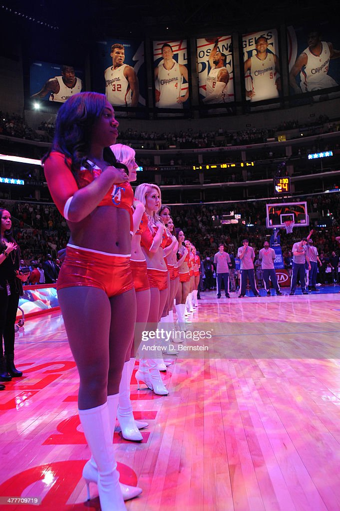 Los Angeles Clippers Spirit Dance team members stand together during the performance of the National Anthem before a game against the Phoenix Suns at Staples Center on March 10, 2014 in Los Angeles, California.