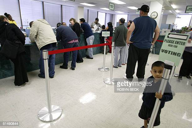 Los Angeles county residents line up to register to vote and to obtain absentee ballots for the US presidential election 17 October 2004 at the Los...