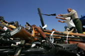 Los Angeles County Sheriff Lee Baca tosses weapons onto a pile of more than 4300 confiscated illegal weapons about to be melted down during the 14th...