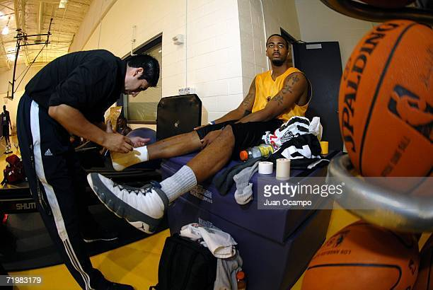 Los Angeles DFenders athletic trainer Marco Nunez tapes up the ankle of Ty Thomas during the NBDL Los Angeles DFenders player tryouts held at the...