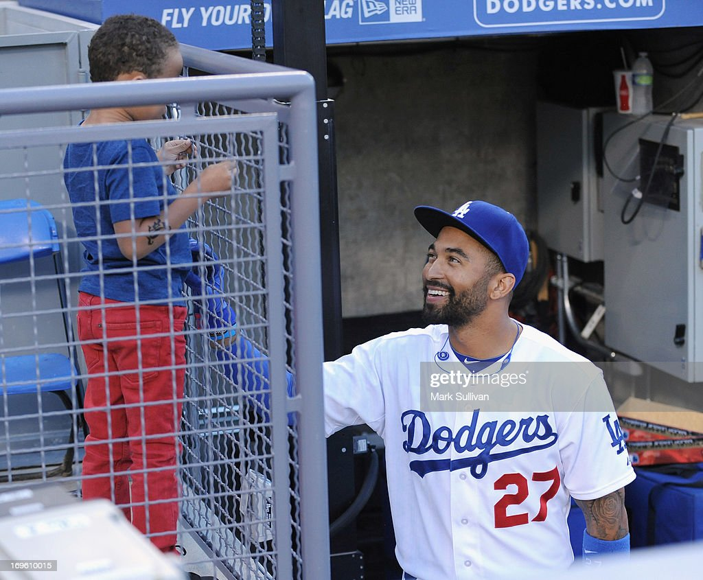Los Angeles Dodger outfielder <a gi-track='captionPersonalityLinkClicked' href=/galleries/search?phrase=Matt+Kemp&family=editorial&specificpeople=567161 ng-click='$event.stopPropagation()'>Matt Kemp</a> (R) greets a child before the game between the Los Angeles Dodgers and the Los Angeles Angels of Anaheim at Dodger Stadium on May 28, 2013 in Los Angeles, California.