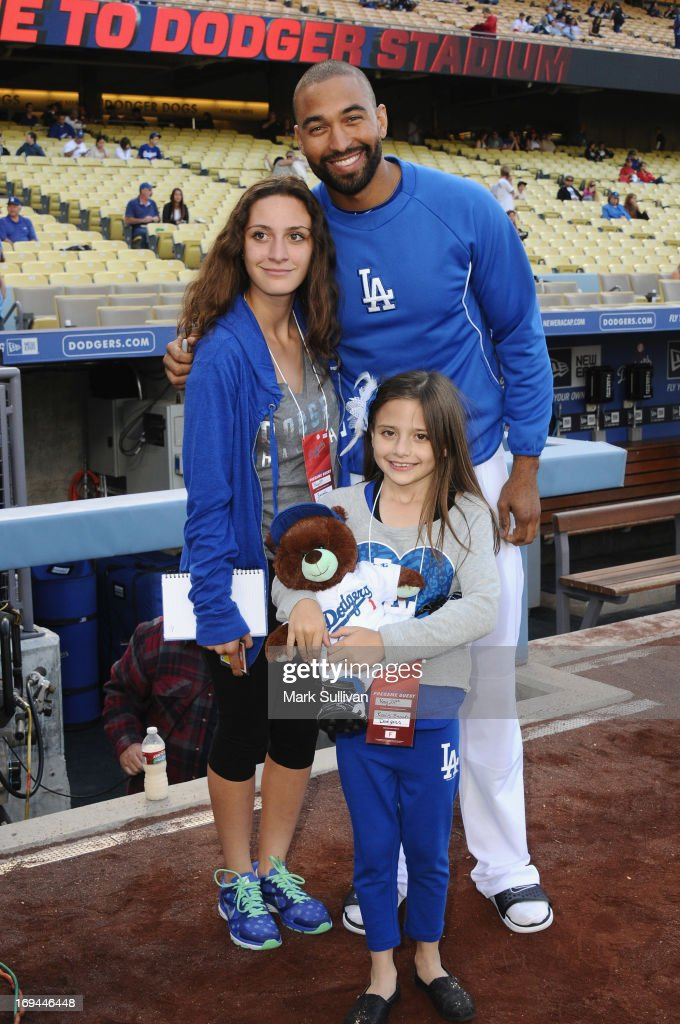 Los Angeles Dodger outfielder <a gi-track='captionPersonalityLinkClicked' href=/galleries/search?phrase=Matt+Kemp&family=editorial&specificpeople=567161 ng-click='$event.stopPropagation()'>Matt Kemp</a> (R) poses with fans before the game between the St. Louis Cardinals and the Los Angeles Dodgers at Dodger Stadium on May 24, 2013 in Los Angeles, California.