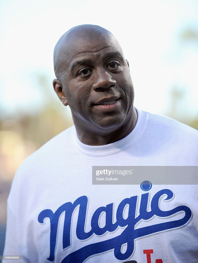Los Angeles Dodger partner Earvin 'Magic' Johnson on the field during Magic Johnson T-Shirt night before the game between the Los Angeles Dodgers and the Los Angeles Angels of Anaheim at Dodger Stadium on May 28, 2013 in Los Angeles, California.