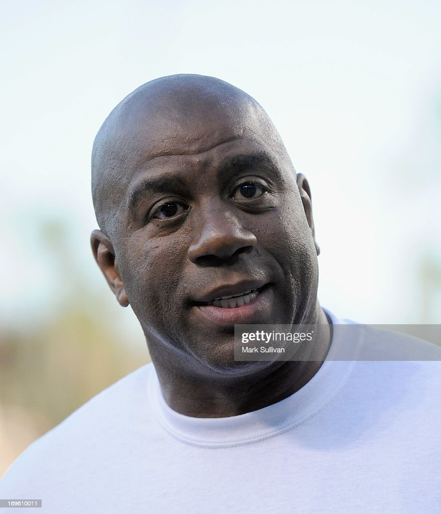 Los Angeles Dodger partner Earvin 'Magic' Johnson on the field during <a gi-track='captionPersonalityLinkClicked' href=/galleries/search?phrase=Magic+Johnson&family=editorial&specificpeople=157511 ng-click='$event.stopPropagation()'>Magic Johnson</a> T-Shirt night before the game between the Los Angeles Dodgers and the Los Angeles Angels of Anaheim at Dodger Stadium on May 28, 2013 in Los Angeles, California.