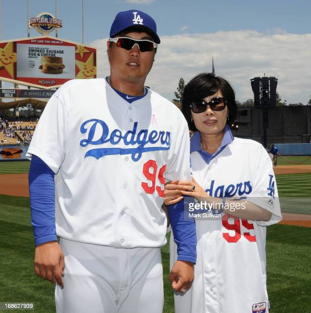 Los Angeles Dodger pitcher HyunJin Ryu poses with his mother on the field before the MLB game against the Miami Marlins on Mother's Day at Dodger...