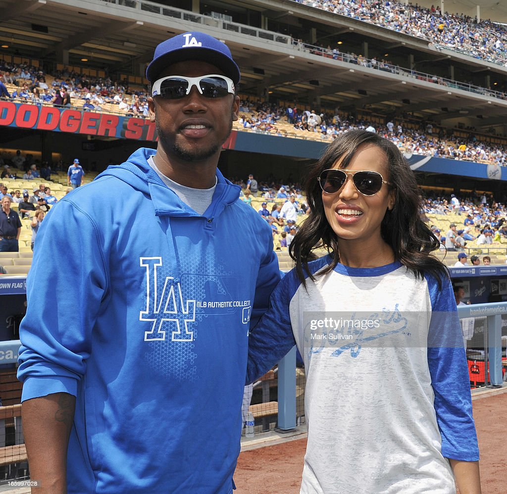 Los Angeles Dodger player <a gi-track='captionPersonalityLinkClicked' href=/galleries/search?phrase=Hanley+Ramirez&family=editorial&specificpeople=538406 ng-click='$event.stopPropagation()'>Hanley Ramirez</a> and actress <a gi-track='captionPersonalityLinkClicked' href=/galleries/search?phrase=Kerry+Washington&family=editorial&specificpeople=201534 ng-click='$event.stopPropagation()'>Kerry Washington</a> pose on field at Dodger Stadium on April 7, 2013 in Los Angeles, California.