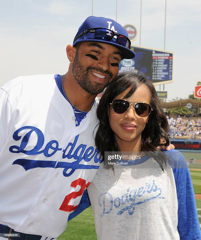 Los Angeles Dodger player Matt Kemp and actress Kerry Washington pose on field at Dodger Stadium on April 7, 2013 in Los Angeles, California.