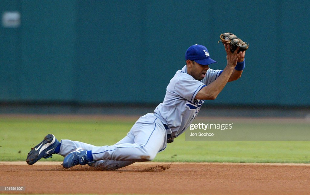 Los Angeles Dodgers <a gi-track='captionPersonalityLinkClicked' href=/galleries/search?phrase=Alex+Cora&family=editorial&specificpeople=206664 ng-click='$event.stopPropagation()'>Alex Cora</a> dives and gets St. Louis Cardinals <a gi-track='captionPersonalityLinkClicked' href=/galleries/search?phrase=So+Taguchi&family=editorial&specificpeople=183399 ng-click='$event.stopPropagation()'>So Taguchi</a> in the 3rd inning Saturday, September 4, 2004 at Busch Stadium in St. Louis, Missouri.The Cardinals beat the Dodgers 5-1.