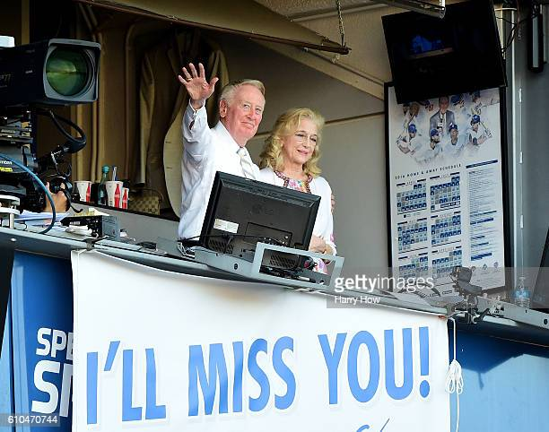 Los Angeles Dodgers announcer Vin Scully and his wife Sandra Hunt acknowedge the crowds applause for his 67 years of service after a 43 win over the...
