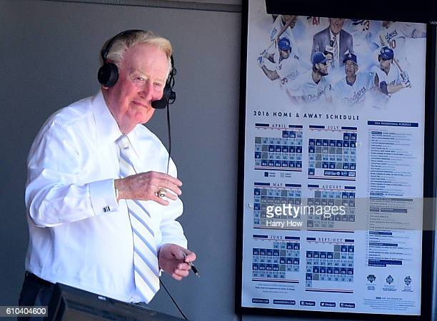 Los Angeles Dodgers announcer Vin Scully smiles to the crowd before his final home game after 67 years at the post before the game against the...