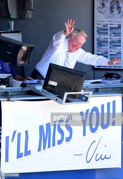 Los Angeles Dodgers announcer Vin Scully waves to the crowd before his final home game after 67 years at the post before the game against the...