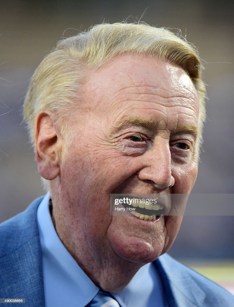 Los Angeles Dodgers broadcaster Vin Scully smiles on the field before the game against the Arizona Diamondbacks at Dodger Stadium on September 23...