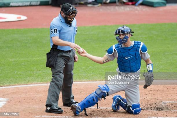 Los Angeles Dodgers catcher Austin Barnes gets a new baseball from home plate umpire Chris Guccione during the first inning of the Major League...