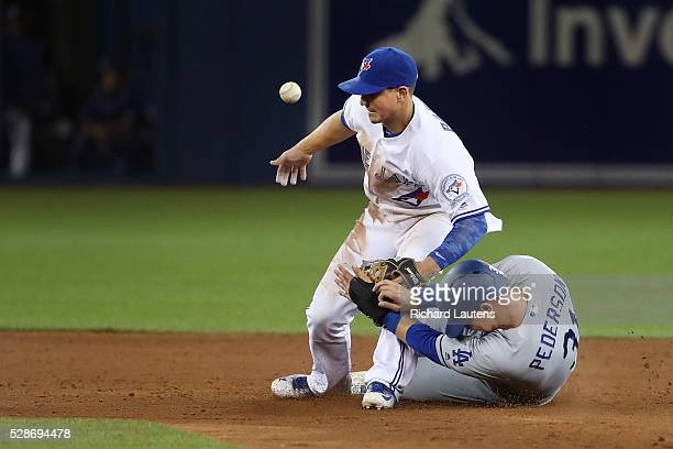 TORONTO ON MAY 6 Los Angeles Dodgers center fielder Joc Pederson was ruled out at second at the hands of Toronto Blue Jays second baseman Darwin...