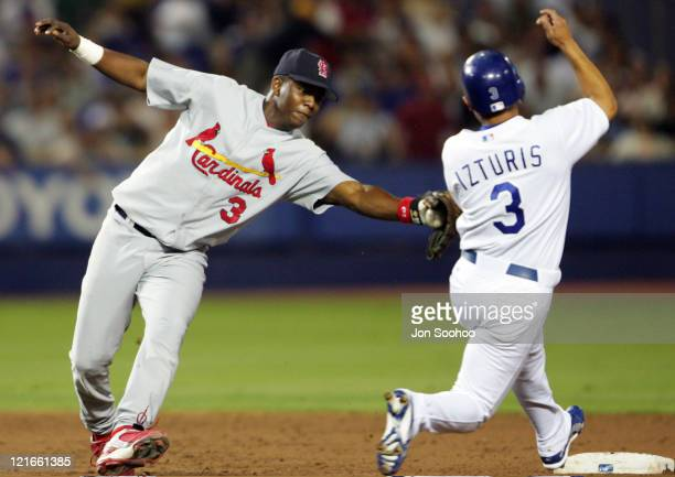 Los Angeles Dodgers Cesar Izturis steals second base in the third inning as St Louis Cardinals Edgar Renteria fails to make the tag Friday September...